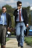 Business men walking. Two young partners are heading up to a meeting Royalty Free Stock Photography