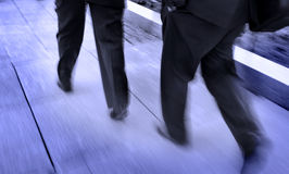 Business Men Walking. Group of businessmen walking and holding briefcases Stock Images