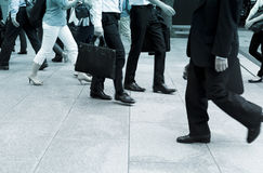 Business men walking. On the pavement Royalty Free Stock Image