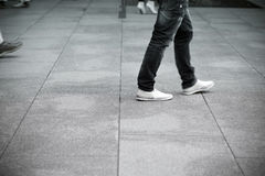 Business men walking. On the pavement Stock Images