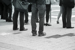 Business men walking. On the pavement Royalty Free Stock Photography