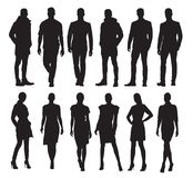 Business men and women in different poses, set of silhouettes. Business men and women in different poses, set of vector silhouettes. Adult people in formal dress Stock Photography