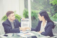 Business man and woman meeting and showing success with handshake stock photos