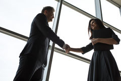 Business men and women shaking hands with a smile Stock Photography