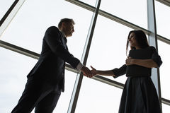 Business men and women shaking hands with a smile Royalty Free Stock Photo