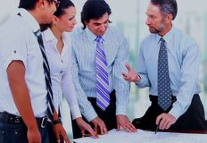 Business meeting - manager discussing work with his colleagues. Stock Image