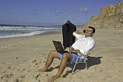 Business men working on the beach ! Royalty Free Stock Photography
