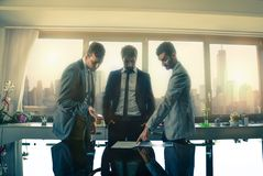 Business men working in the office. Business men meeting in the office - Three employers talking about a project Royalty Free Stock Photo