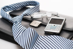 Business mens' accessories tie briefcase phone Royalty Free Stock Photo