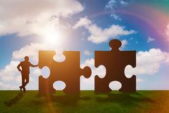 The business metaphor of teamwork with jigsaw puzzle Royalty Free Stock Photography