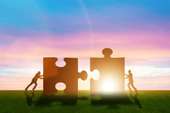 The business metaphor of teamwork with jigsaw puzzle Royalty Free Stock Photos