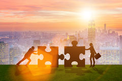The business metaphor of teamwork with jigsaw puzzle Stock Image