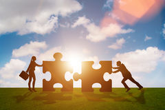 The business metaphor of teamwork with jigsaw puzzle Stock Images