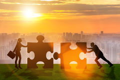 The business metaphor of teamwork with jigsaw puzzle Royalty Free Stock Images