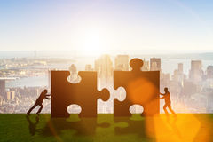 The business metaphor of teamwork with jigsaw puzzle Stock Photos