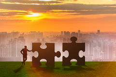 The business metaphor of teamwork with jigsaw puzzle Stock Photo