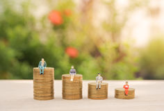 Business miniature people and money stack gold coin Royalty Free Stock Photography