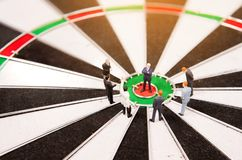 Business miniature people standing on dartboard Stock Image