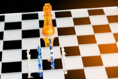 Business miniature team with chess Royalty Free Stock Image
