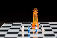 Business miniature team with chess Royalty Free Stock Photos
