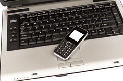 Business Mobile Phone On Laptop Stock Images