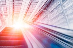 Business modern hall building with escalator stair with light stock image