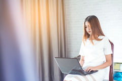 Business Modern woman. Using laptop with report working Stock Image
