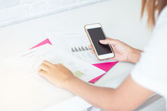 Business Modern women using mobile phone. With report working Royalty Free Stock Photos