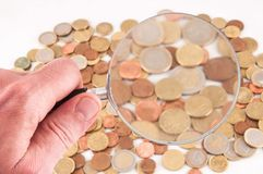 Business Money Concept Idea. Picture of a Business Money Concept Idea Coins and Loupe Magnify Glass stock image