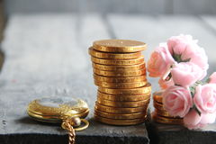 Business or money concept. Stacks of golden coins. Stacks of golden coins on vintage yable. Business or finance concept Stock Photos