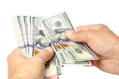 Business Money Dollars In The Hands On A White Background Stock Image