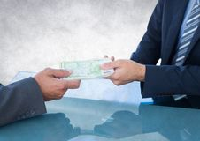 Business money exchange at blue desk against white grunge background Stock Image