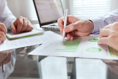 Business monitoring concept, finance strategy. Business monitoring, close up on hand with pen, infographics Stock Image