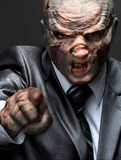 Business monster suit pointing to you. Angry monster in business suit pointing to you Royalty Free Stock Photography