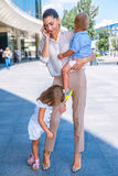 Business mother speaking over the cellphone Stock Photography