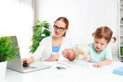 Business  mother works at home via the Internet with their child Stock Photography