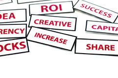 Business motivation word  IDEA, ROI, CURRENCY, CREATIVE, STOCKS and INCREASE printed on paper. With red color isolated on white background Stock Photos