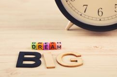 Colorful cubes with words DREAM BIG on wooden desk royalty free stock photo