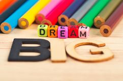 Colorful cubes with words DREAM BIG on wooden desk stock image