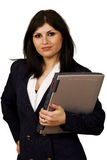Business on the move. Smart stylish businesswoman on the move holding laptop Royalty Free Stock Images