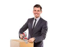 Business moving in office. Young happy businessman with box for moving into a new office. Studio shot, isolated on a white background stock image