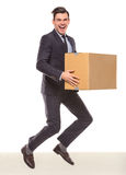Business moving in office. Young happy businessman with box for moving into a new office. Studio shot, isolated on a white background Royalty Free Stock Photo