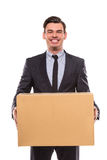 Business moving in office. Young happy businessman with box for moving into a new office. Studio shot, isolated on a white background royalty free stock photos