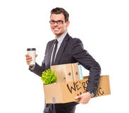 Business moving in office. Young happy businessman with box for moving into a new office. Studio shot, isolated on a white background Royalty Free Stock Image