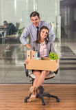 Business moving in office. Young happy businessman and a business women with boxes for moving into a new office Royalty Free Stock Photos