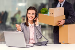 Business moving in office. Young happy businessman and a business women with boxes for moving into a new office royalty free stock photo
