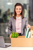 Business moving in office. Young happy business woman with boxes for moving into a new office Stock Photo