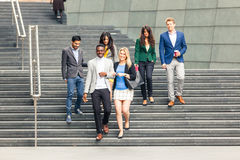 Business multiracial group walking in London royalty free stock photos
