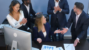 Business multiracial team applauding to each other in office. Top view. Professional shot in 4K resolution. 085. You can use it e.g. in your commercial video Royalty Free Stock Photo