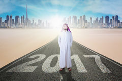 Business muslim standing on street with 2017 Stock Images